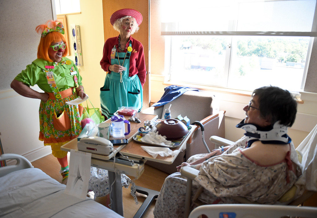 ". Caring Clowns Kathy ""Marmalade\"" Shook, left, and Loretta \""Madame Larkspur\"" Milburn tell jokes to Brent Boyer at Longmont United Hospital, 1950 Mountain View Ave., Tuesday morning. To view more photos and a video visit timescall.com. Lewis Geyer/Staff Photographer Sept. 12, 2017"