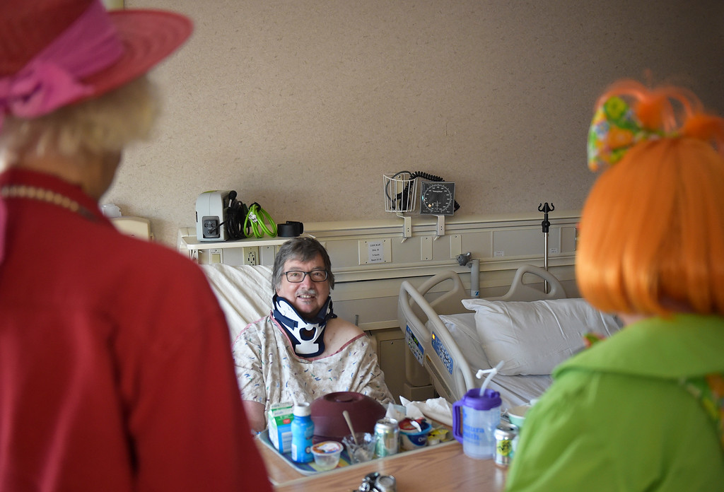 ". Patient Brett Boyer enjoys a visit from Caring Clowns Loretta ""Madame Larkspur\"" Milburn, left, and Kathy \""Marmalade\"" Shook at Longmont United Hospital, 1950 Mountain View Ave., Tuesday morning. To view more photos and a video visit timescall.com. Lewis Geyer/Staff Photographer Sept. 12, 2017"