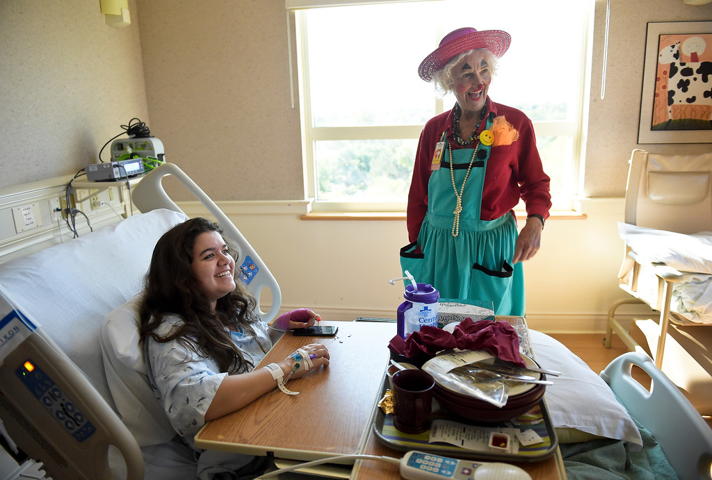 ". Loretta ""Madame Larkspur\"" Milburn, who is a retired medical doctor, visits patient Emma McCauley, 16, at Longmont United Hospital, 1950 Mountain View Ave., Tuesday morning. To view more photos and a video visit timescall.com. Lewis Geyer/Staff Photographer Sept. 12, 2017"