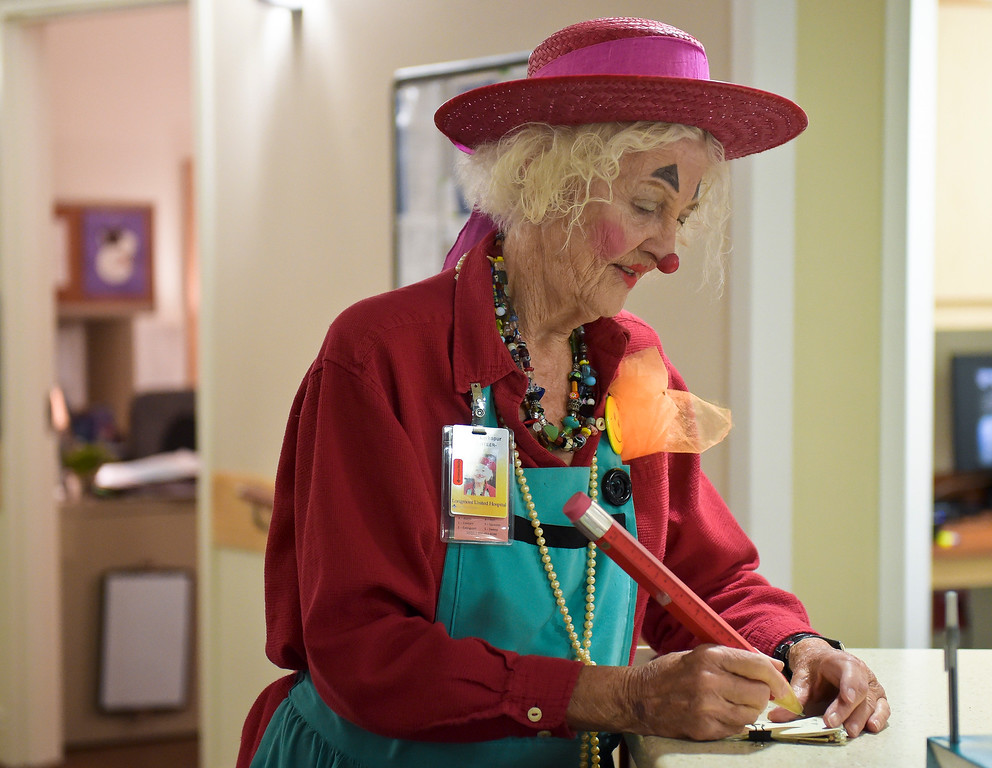 ". Loretta ""Madame Larkspur\"" Milburn, who is a retired medical doctor, takes notes while preparing to visit patients on the 5th floor at Longmont United Hospital, 1950 Mountain View Ave., Tuesday morning. To view more photos and a video visit timescall.com. Lewis Geyer/Staff Photographer Sept. 12, 2017"