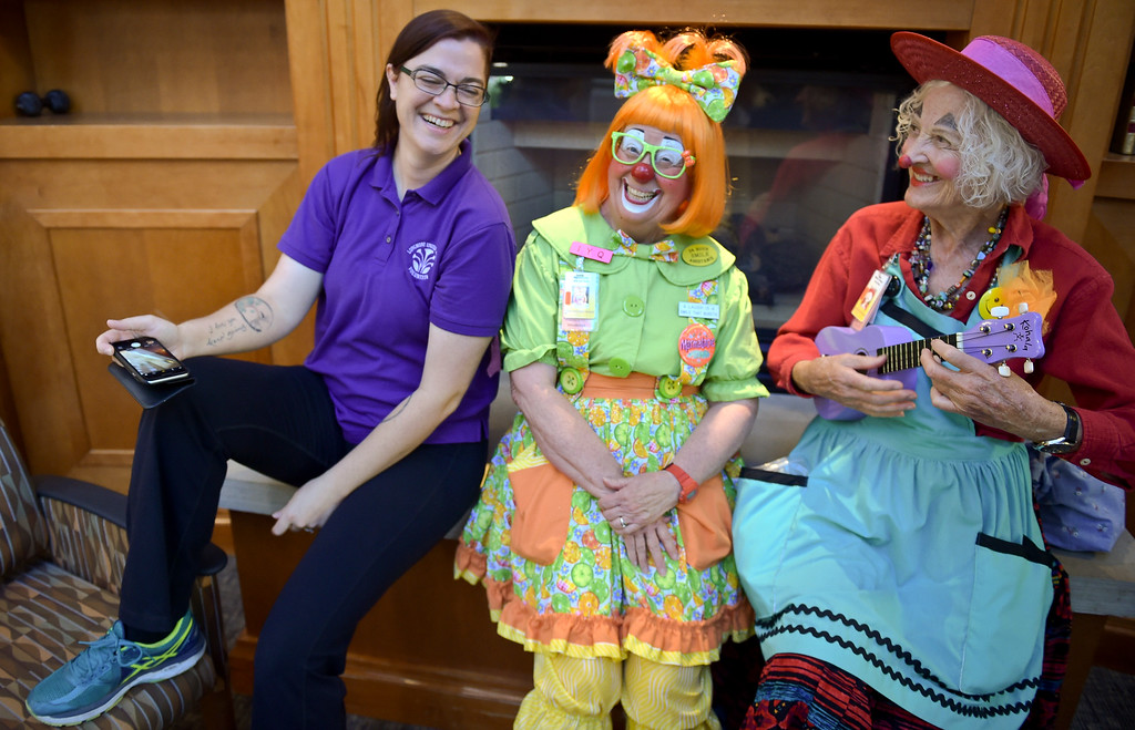 ". From left: Volunteer Breanne Meyer meets Caring Clown volunteers Kathy ""Marmalade\"" Shook and Loretta \""Madame Larkspur\"" Milburn in the lobby of Longmont United Hospital, 1950 Mountain View Ave., Tuesday morning. To view more photos and a video visit timescall.com. Lewis Geyer/Staff Photographer Sept. 12, 2017"