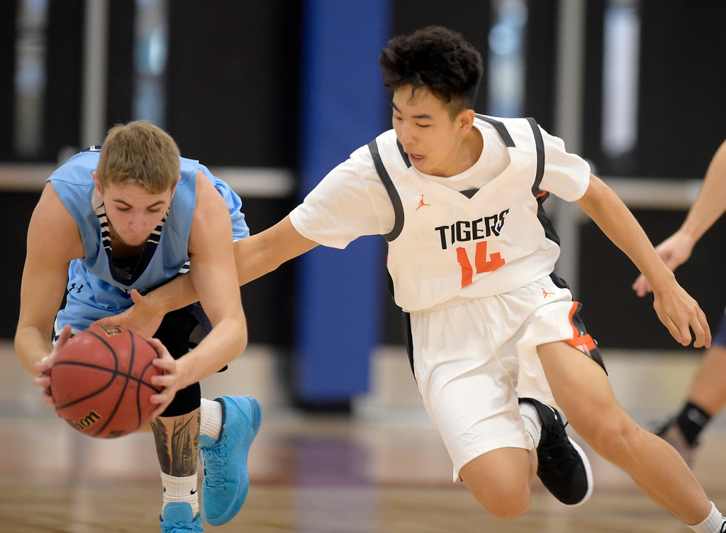 . LAFAYETTE, CO - DECEMBER 5: Erie\'s Jordan Nguyen reaches for the ball against Trinidad\'s Dalton Chongway in the second quarter during the Centaurus Warrior Classic December 5, 2018 at Centaurus High School. To view more photos visit bocopreps.com. (Photo by Lewis Geyer/Staff Photographer)