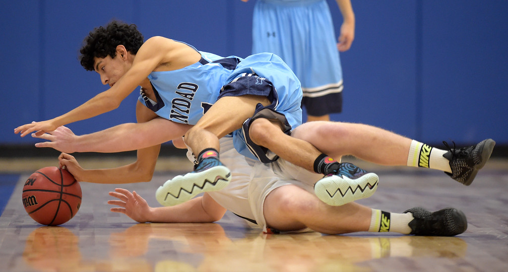 . LAFAYETTE, CO - DECEMBER 5: Trinidad\'s Noah Robinson crawls over Erie\'s Austin Rodriguez in the second quarter during the Centaurus Warrior Classic December 5, 2018 at Centaurus High School. To view more photos visit bocopreps.com. (Photo by Lewis Geyer/Staff Photographer)