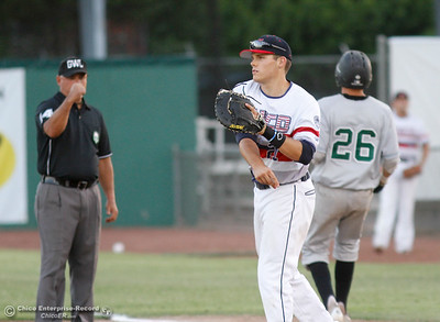 Chico Heat's first baseman Cameron Olson throws the ball to the pitcher after outing Medford Rogues player July 6, 2016 at Nettleton Stadium in Chico, Calif. (Emily Bertolino -- Enterprise-Record)