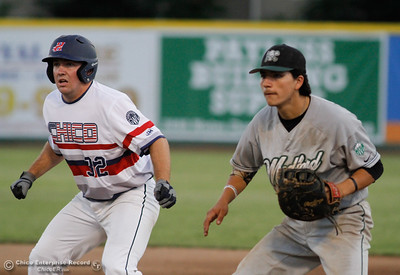 Medford Rogues's Johnny DeLaCruz guards first as Chico Heat's Keaton Kringlenwaits for the cue to run to second July 6, 2016 at Nettleton Stadium in Chico, Calif. (Emily Bertolino -- Enterprise-Record)