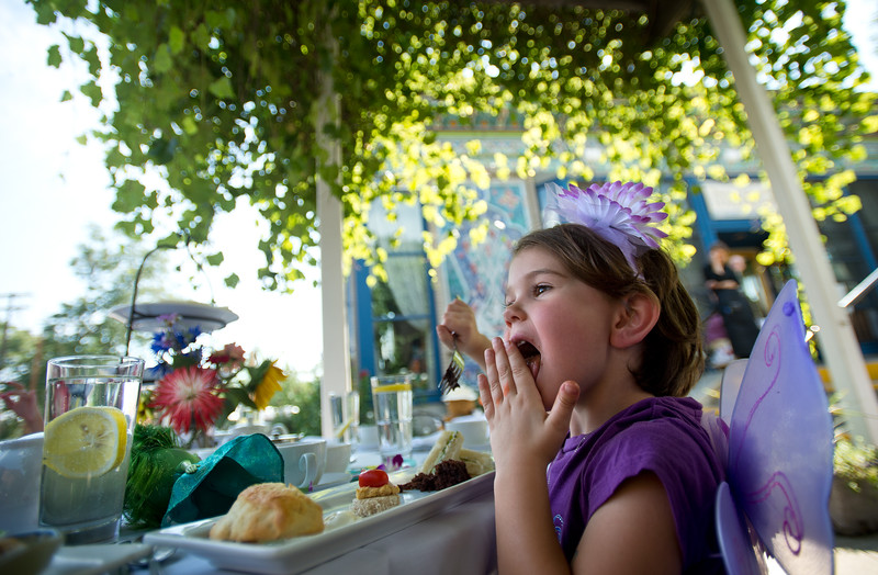 "Farrah Broach, 4, licks chocolate cake off her hand during the Children's Teddy Bear Tea Party, as part of the 16th annual Rocky Mountain Tea Festival at the Dushanbe Teahouse in Boulder on Sunday.<br /> More photos:  <a href=""http://www.dailycamera.com"">http://www.dailycamera.com</a><br /> (Autumn Parry/Staff Photographer)<br /> July 31, 2016"