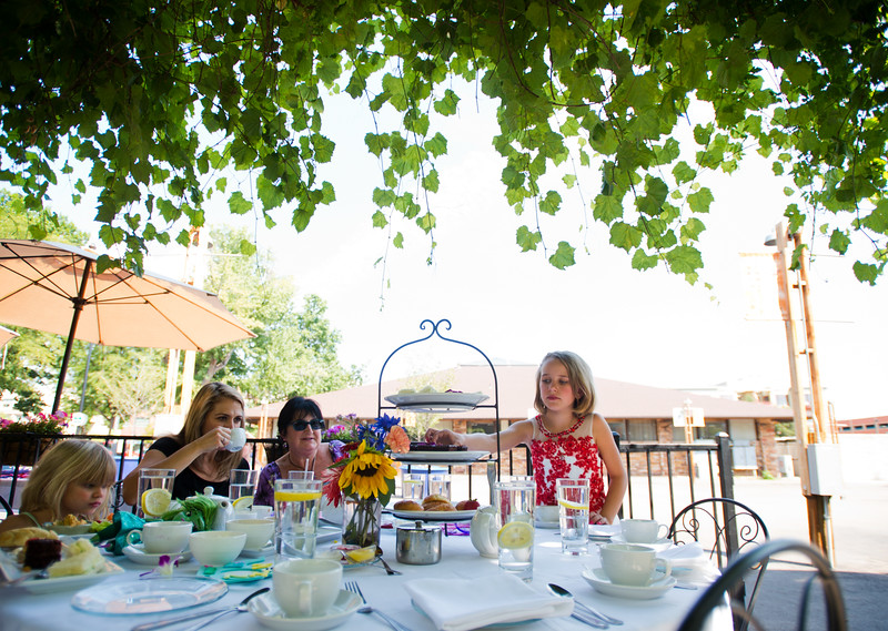 "Scarlett Broach, 8, (right) helps herself to a piece of chocolate cake during the Children's Teddy Bear Tea Party, as part of the 16th annual Rocky Mountain Tea Festival at the Dushanbe Teahouse in Boulder on Sunday.<br /> More photos:  <a href=""http://www.dailycamera.com"">http://www.dailycamera.com</a><br /> (Autumn Parry/Staff Photographer)<br /> July 31, 2016"