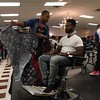 Richard Payerchin - The Morning Journal <br> A competing barber gets ready to put his barber cloth over a model during the first Steel City Barber Expo held July 16, 2017, at Rosewood Place, 4493 Oberlin Ave., Lorain. Barbers battled for a championship belt in the event sponsored by La Fortaleza and Headlinerz Barbership.