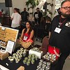 "Richard Payerchin - The Morning Journal <br> Michelle Athanas, center, and Tim Novak, right, two of the four founders of Midwest Best Grooming Co., operate their booth at the first Steel City Barber Expo held July 16, 2017, at Rosewood Place, 4493 Oberlin Ave., Lorain. ""We want to change the world one beard at a time,"" said Novak."