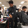 Richard Payerchin - The Morning Journal <br> A competing barber gets ready to cut during the first Steel City Barber Expo held July 16, 2017, at Rosewood Place,, 4493 Oberlin Ave., Lorain. Barbers battled for a championship belt in the event sponsored by La Fortaleza and Headlinerz Barbership.