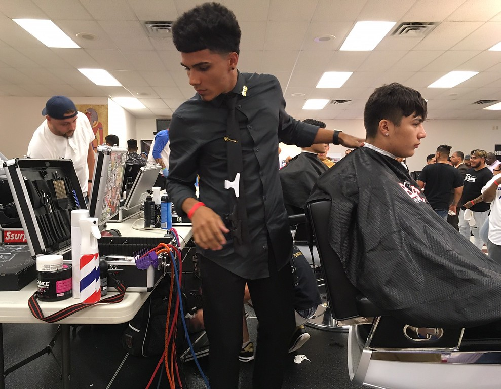 . Richard Payerchin - The Morning Journal <br> A competing barber gets ready to cut during the first Steel City Barber Expo held July 16, 2017, at Rosewood Place,, 4493 Oberlin Ave., Lorain. Barbers battled for a championship belt in the event sponsored by La Fortaleza and Headlinerz Barbership.