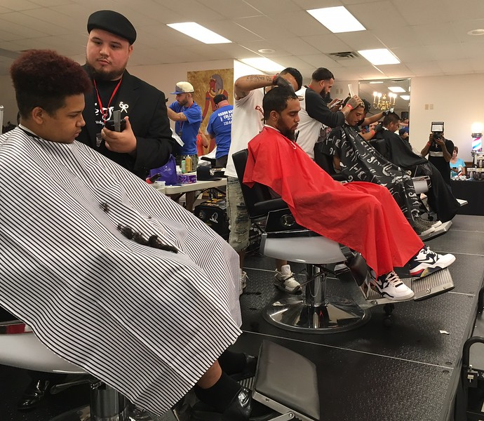 Richard Payerchin - The Morning Journal <br> Student barbers cut hair for models during the first Steel City Barber Expo held July 16, 2017, at Rosewood Place, 4493 Oberlin Ave., Lorain. Barbers battled for a championship belt in the event sponsored by La Fortaleza and Headlinerz Barbership.