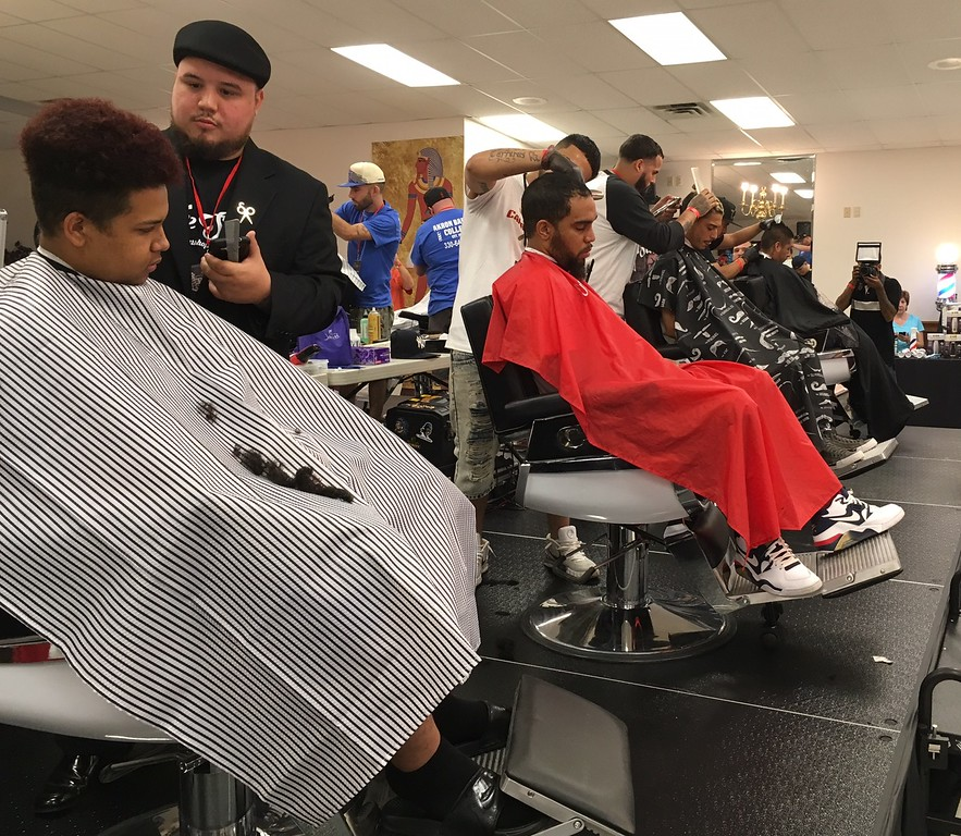 . Richard Payerchin - The Morning Journal <br> Student barbers cut hair for models during the first Steel City Barber Expo held July 16, 2017, at Rosewood Place, 4493 Oberlin Ave., Lorain. Barbers battled for a championship belt in the event sponsored by La Fortaleza and Headlinerz Barbership.