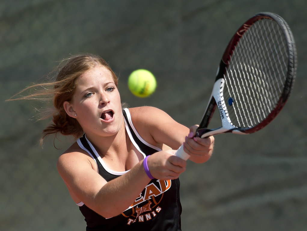 . Mead\'s Haley Vavla hits a return during a #3 singles match at the 3A state tennis tournament in Greeley Thursday. To view more photos visit bocopreps.com. Lewis Geyer/Staff Photographer May 10, 2018