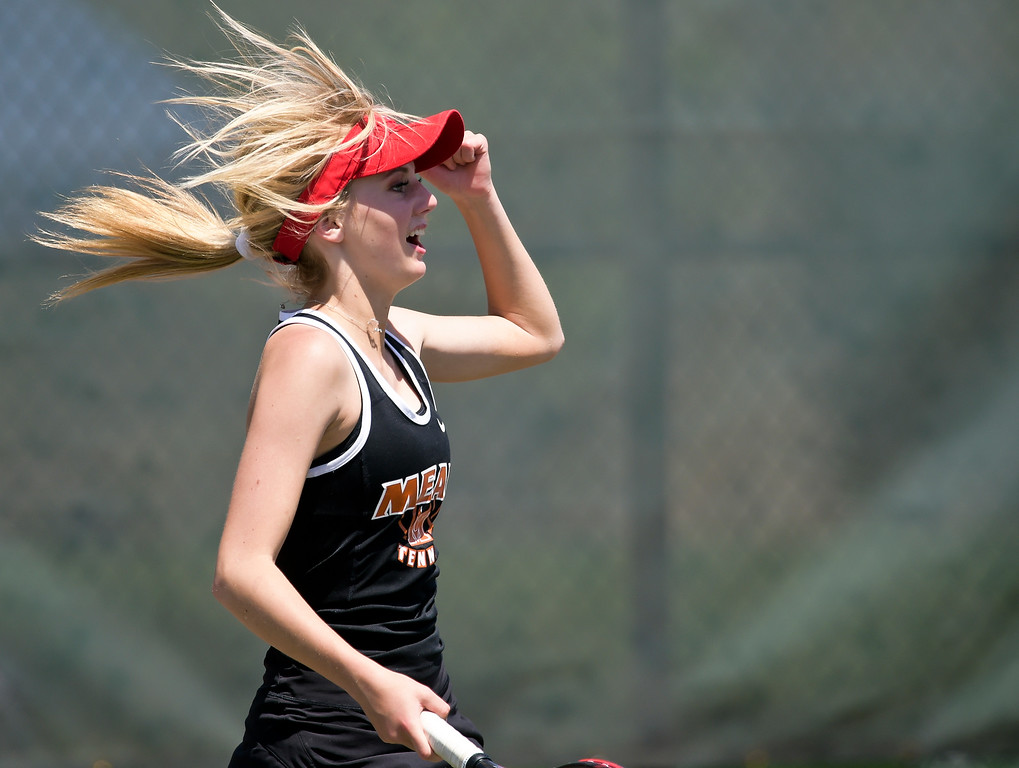 . Mead\'s Ashton Selke celebrates during a #2 doubles match with teammate Ashley Andrews during the 3A state tennis tournament in Greeley Thursday. To view more photos visit bocopreps.com. Lewis Geyer/Staff Photographer May 10, 2018