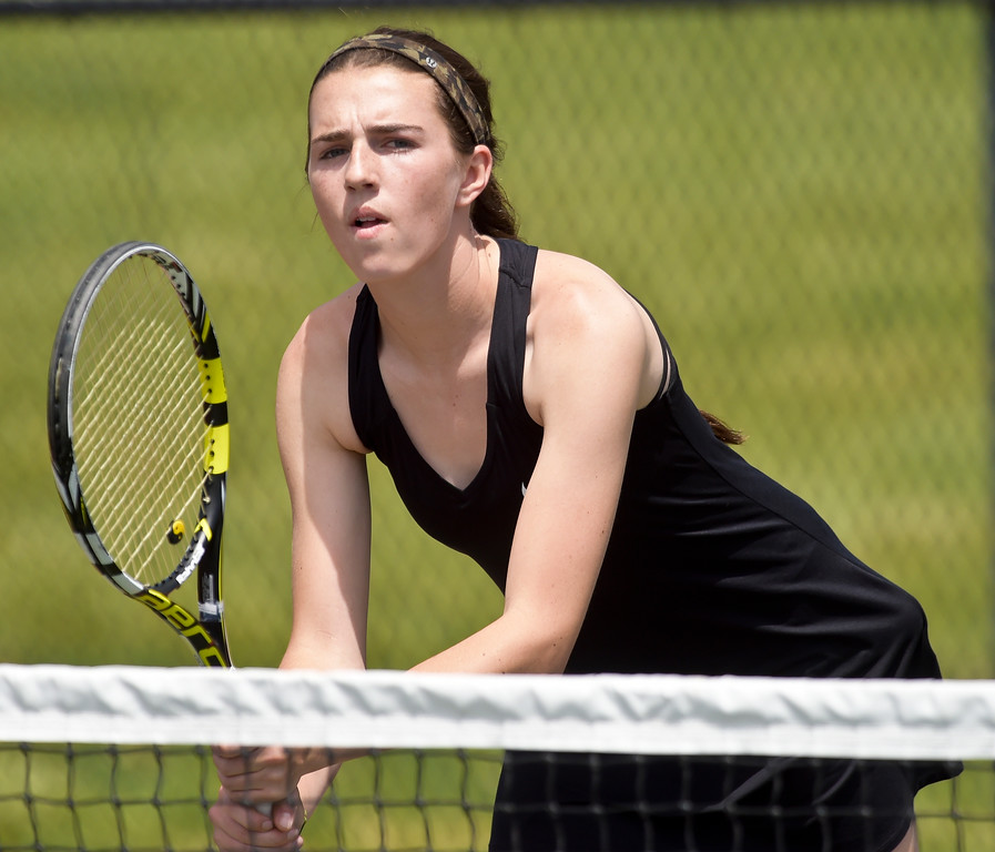 . Holy Family\'s Ciara Donovan waits for the serve during a doubles match at the 3A state tennis tournament in Greeley Thursday. To view more photos visit bocopreps.com. Lewis Geyer/Staff Photographer May 10, 2018