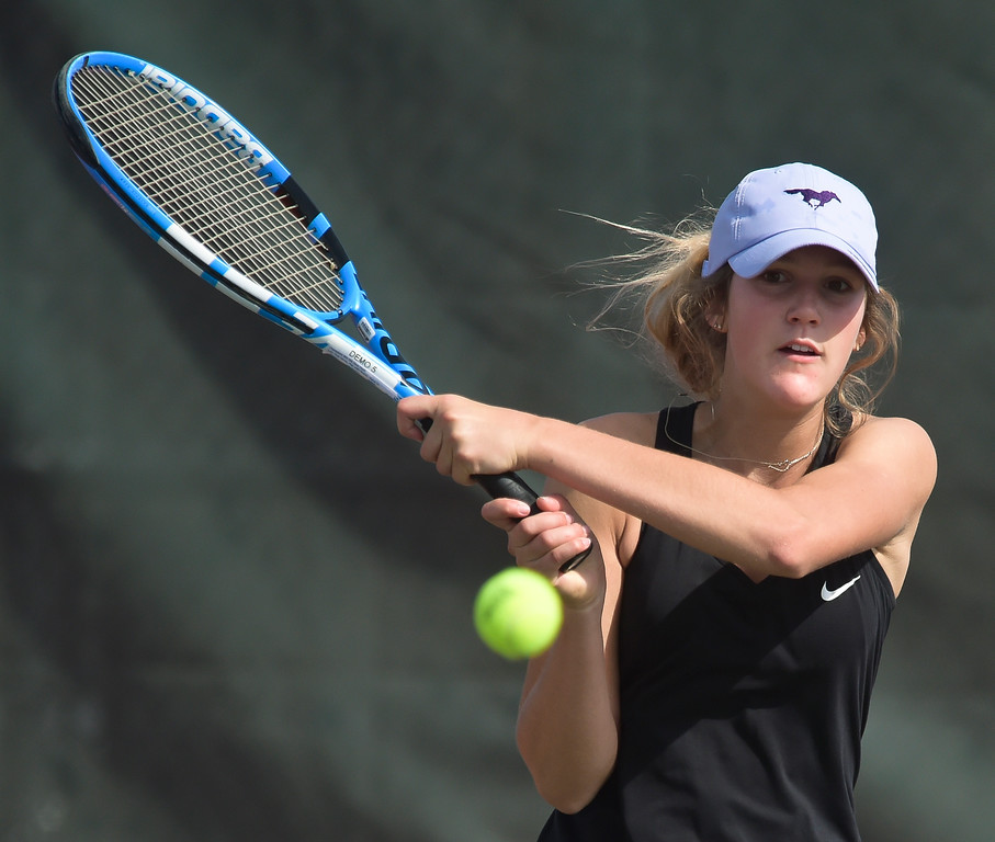 . Holy Family\'s Julia Giltner hits a return during her first #1 singles match at the 3A state tennis tournament in Greeley Thursday. To view more photos visit bocopreps.com. Lewis Geyer/Staff Photographer May 10, 2018