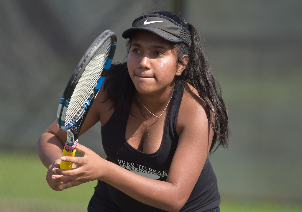 . Peak to Peak\'s Trini Somasundaram competes in a #2 singles match at the 3A state tennis tournament in Greeley Thursday. To view more photos visit bocopreps.com. Lewis Geyer/Staff Photographer May 10, 2018