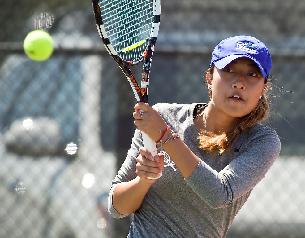 . Holy Family\'s An Tran hits a return during a #3 singles match at the 3A state tennis tournament in Greeley Thursday. To view more photos visit bocopreps.com. Lewis Geyer/Staff Photographer May 10, 2018