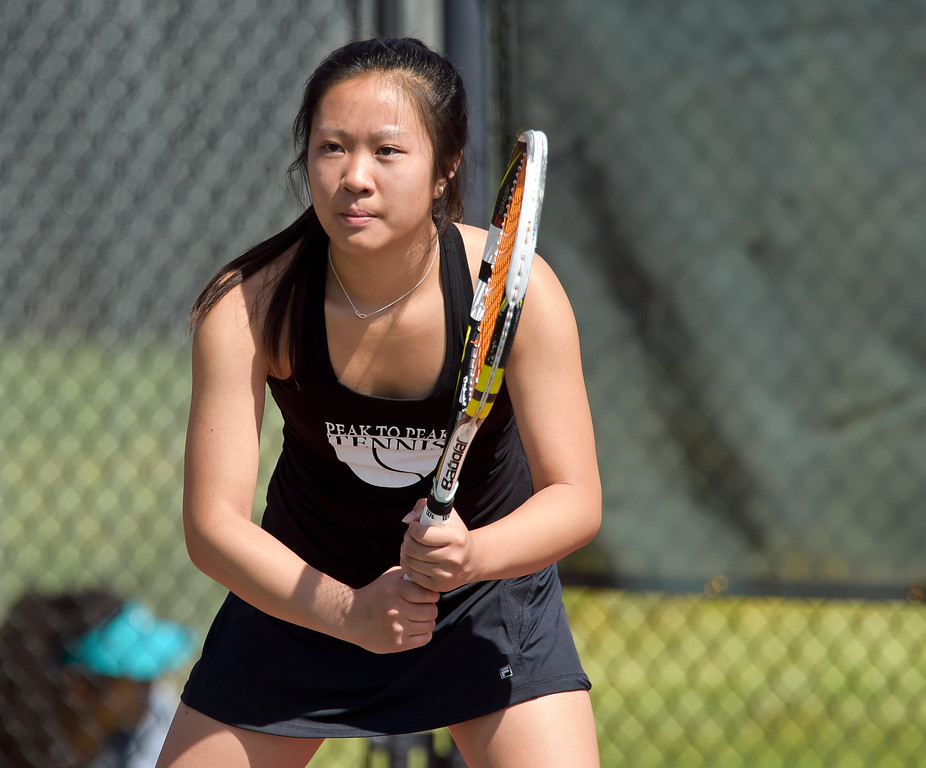 . Peak to Peak\'s Tiffany Tran waits for a serve during a #3 singles match at the 3A state tennis tournament in Greeley Thursday. To view more photos visit bocopreps.com. Lewis Geyer/Staff Photographer May 10, 2018