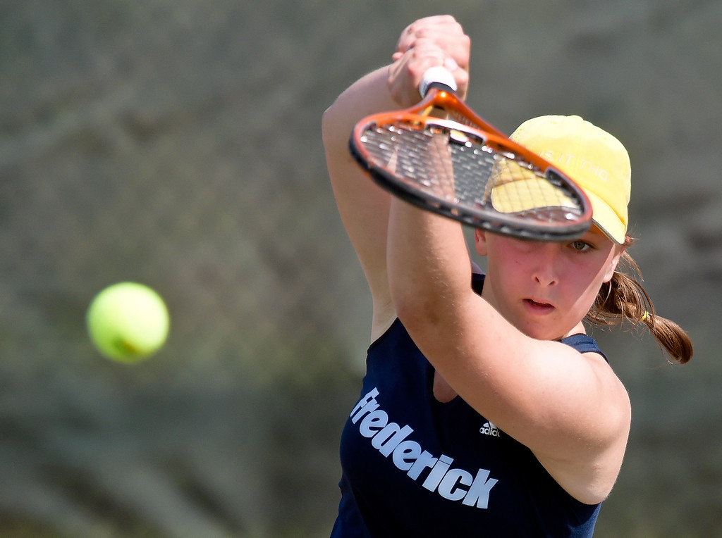 . Frederick\'s Jessica Kelley hits a return during a #2 singles match at the 3A state tennis tournament in Greeley Thursday. To view more photos visit bocopreps.com. Lewis Geyer/Staff Photographer May 10, 2018