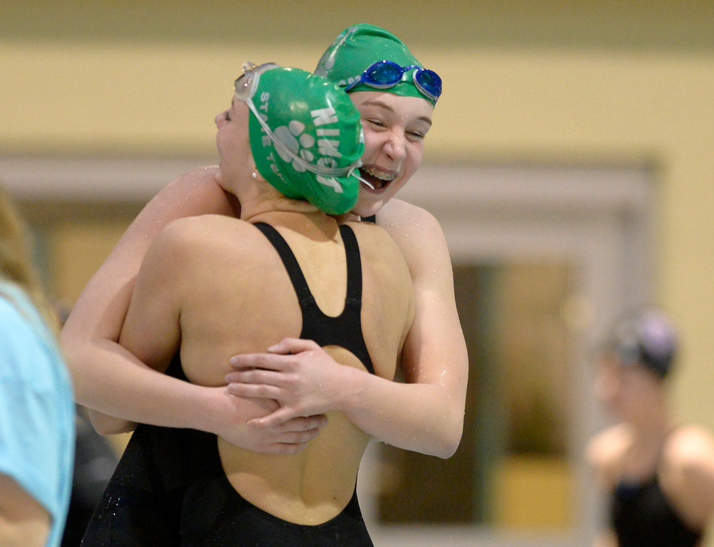 . THORNTON, CO - FEBRUARY 8: Niwot\'s Mary Codevilla, right, gets a hug from teammate Abbie Shaw after Codevilla won the 200 yard IM during the girls 4A swimming and diving championships February 8, 2019 at the Veterans Memorial Aquatic Center in Thornton. To view more photos visit bocopreps.com. (Photo by Lewis Geyer/Staff Photographer)