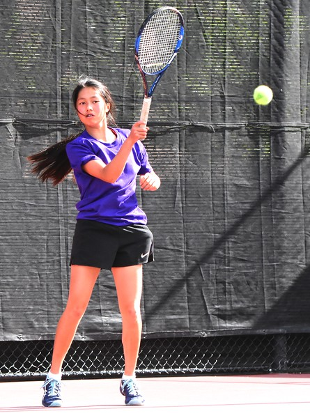 Boulder's Gigi Jensen hits a return during the first day of the Class 5A girls tennis state championships on Thursday, May 10, at Gates Tennis Center in Denver.