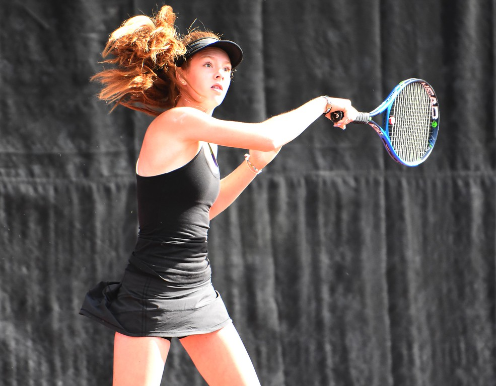 . Monarch\'s Natalie Sprenger hits a return during the first day of the Class 5A girls tennis state championships on Thursday, May 10, at Gates Tennis Center in Denver.
