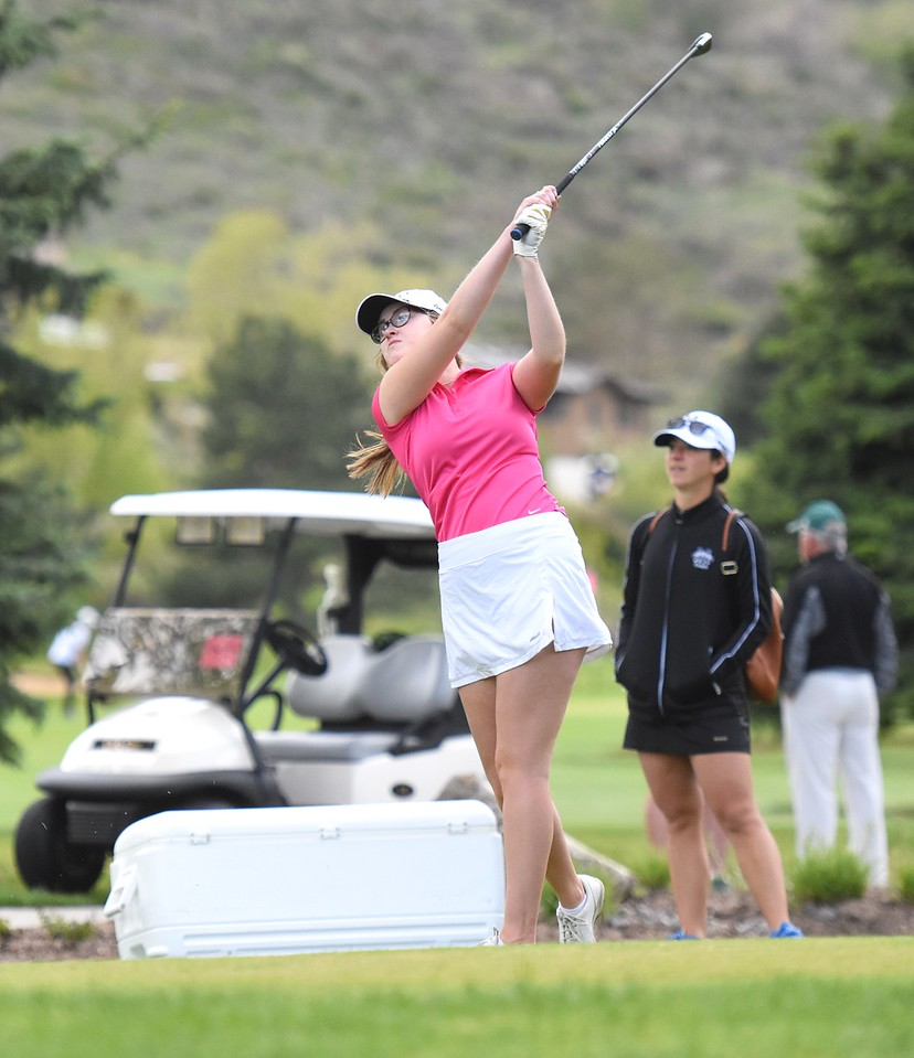 Monarch's Emma Teuton hits a tee shot on the par-3 third hole during the Class 5A girls golf state championships on Monday at The Club at Rolling Hills in Golden.