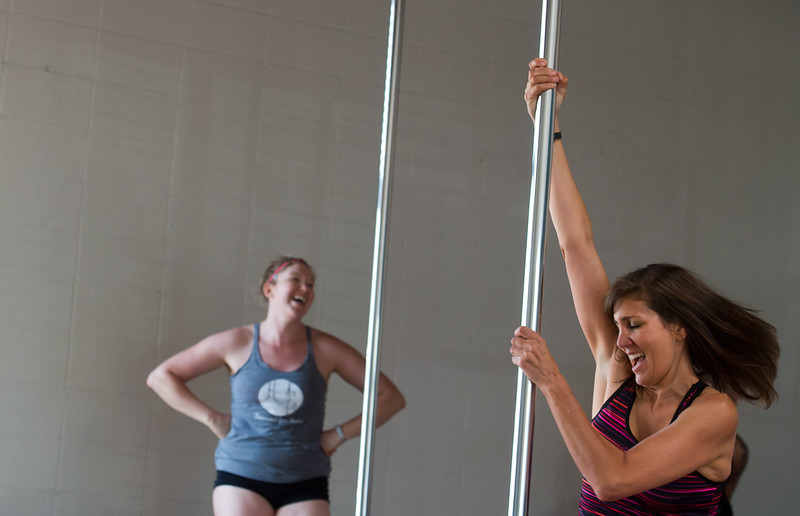 "Eliza Rayner tries a technique during the Co-Ed Novice Pole class at Vertical Fusion on Saturday.<br /> For more photos go to  <a href=""http://www.dailycamera.com"">http://www.dailycamera.com</a><br /> (Autumn Parry/Staff Photographer)<br /> August 20, 2016"
