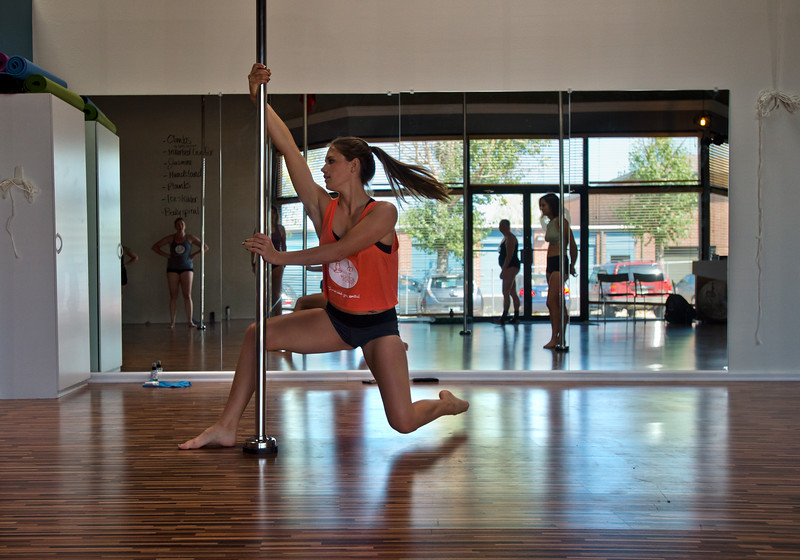 "Instructor Laina Reivi demonstrates a technique during the Co-Ed Novice Pole class at Vertical Fusion on Saturday.<br /> For more photos go to  <a href=""http://www.dailycamera.com"">http://www.dailycamera.com</a><br /> (Autumn Parry/Staff Photographer)<br /> August 20, 2016"