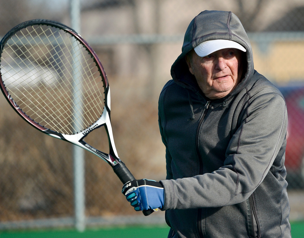 ". LONGMONT, CO - JANUARY 15: Bill Fairchild, 89, chases a shot while playing tennis in 25 degree weather January 15, 2019. ""We are the \'Hardy\' Boys out here,\"" Cathy Young said. The informal group of seniors meets Tuesday, Thursday, and Saturday mornings at Carr Park throughout the year, unless there\'s snow or ice on the courts. \""We always welcome new blood,\"" Fairchild said.  (Photo by Lewis Geyer/Staff Photographer)"