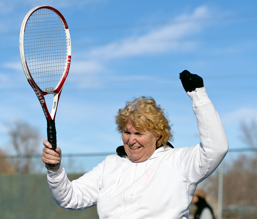 ". LONGMONT, CO - JANUARY 15: Cathy Young, 65, reacts after hitting the ball out of bounds while playing tennis in 25 degree weather January 15, 2019. ""We are the \'Hardy\' Boys out here,\"" Young said. The informal group of seniors meets Tuesday, Thursday, and Saturday mornings at Carr Park throughout the year, unless there\'s snow or ice on the courts. \""We always welcome new blood,\"" Bill Fairchild said. (Photo by Lewis Geyer/Staff Photographer)"