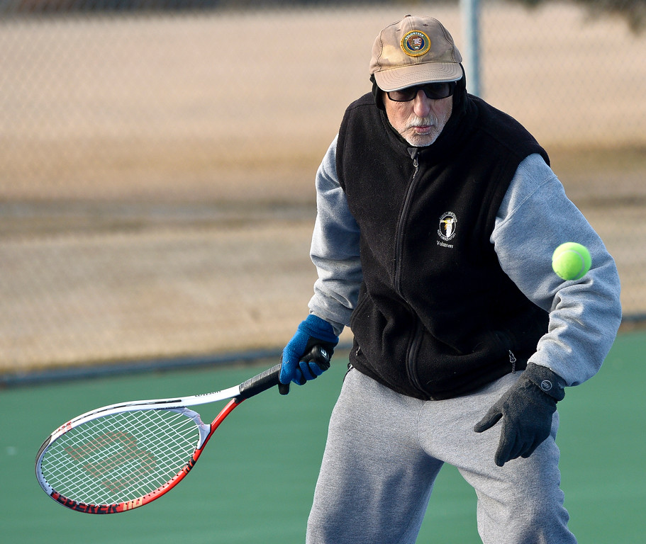 ". LONGMONT, CO - JANUARY 15: Clem Dabrowski, 67, plays tennis in 25 degree weather January 15, 2019. ""We are the \'Hardy\' Boys out here,\"" fellow player Cathy Young said. The informal group of seniors meets Tuesday, Thursday, and Saturday mornings at Carr Park throughout the year, unless there\'s snow or ice on the courts. \""We always welcome new blood,\"" Bill Fairchild said. (Photo by Lewis Geyer/Staff Photographer)"