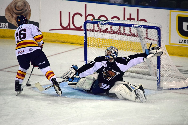Colorado Eagles forward Michael Joly (16) dekes Utah goalie Kevin Carr for a goal Friday Oct. 13, 2017 at the Budweiser Events Center. (Sierra Spiller / Colorado Eagles)