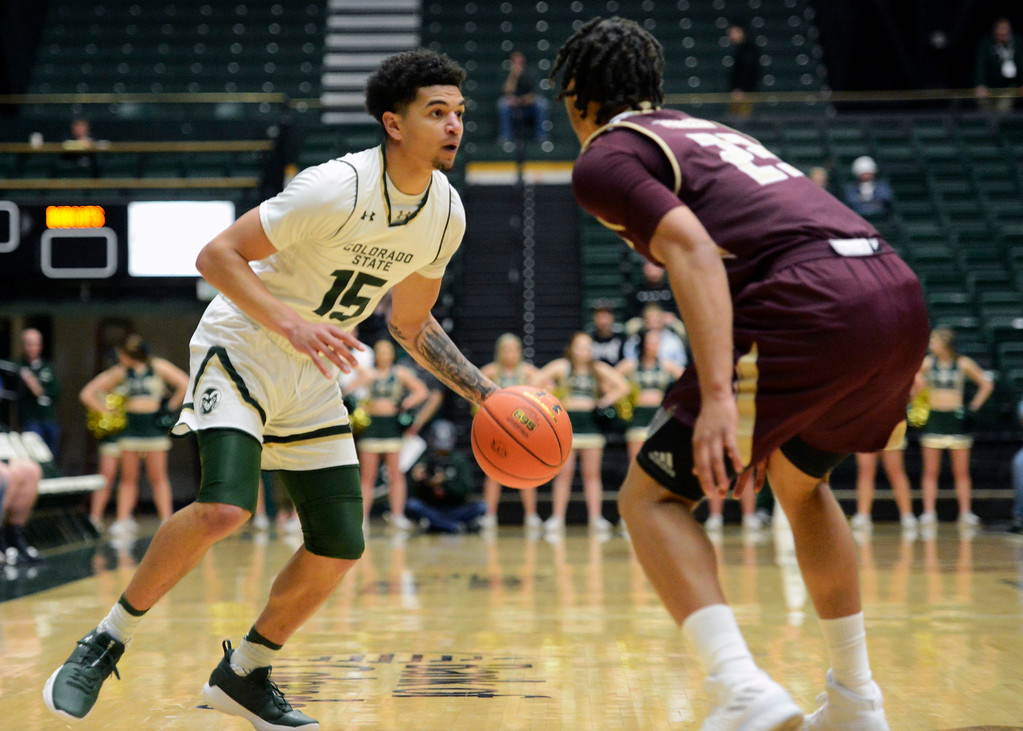 . Colorado State\'s Anthony Bonner (15) is defended by Texas State\'s Nigal Pearson on Sunday at Moby Arena in Fort Collins. (Sean Star/Loveland Reporter-Herald)