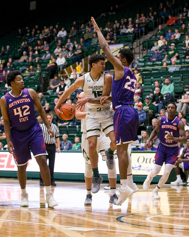 . Colorado State guard Anthony Bonner (15) tries a behind-the-back pass as Northwestern State forward Darian Dixon (23) stops his drive Friday evening Nov., 24, 2017, at Moby Arena in Fort Collins. (Michael Brian/For the Reporter-Herald)