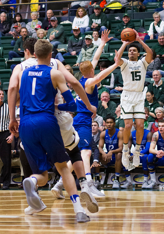 . Colorado State guard Anthony Bonner (15) shoots a three-point shot against Air Force Saturday afternoon Jan., 7, 2016 at Moby Arena in Fort Collins. The Rams beat the visiting Falcons, 85-58. (Michael Brian/For the Reporter-Herald)