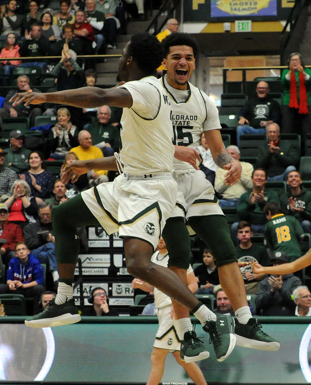 . Colorado State\'s Anthony Bonner, right, and Raquan Mitchell celebrate Mitchell\'s dunk Saturday against Long Beach State.  (Sean Star/Loveland Reporter-Herald)