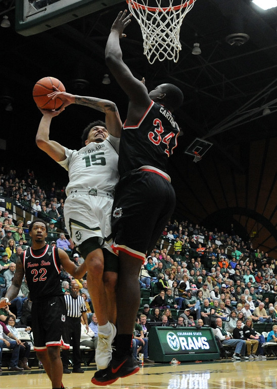 . Colorado State\'s Anthony Bonner, left, is fouled by Fresno State\'s Terrell Carter II on Saturday at Moby Arena.  (Sean Star/Loveland Reporter-Herald)