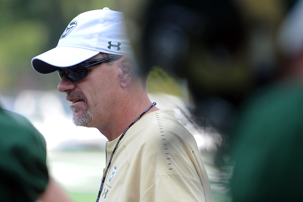 . Colorado State head football coach Mike Bobo patrols the sideline during practice Thursday, August 2, 2018 in Fort Collins, Colorado. (Sean Star/Loveland Reporter-Herald)