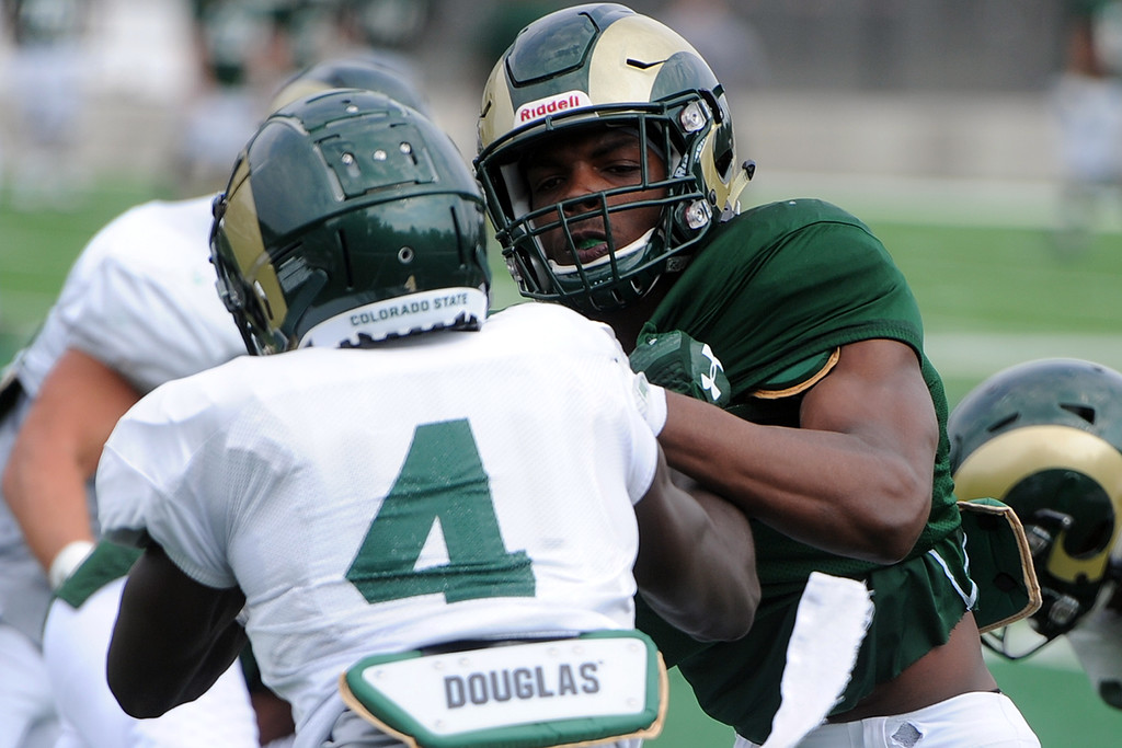 . Wide receiver EJ Scott, right, blocks Rashad Ajayi during practice Thursday, August 2, 2018 in Fort Collins, Colorado. (Sean Star/Loveland Reporter-Herald)
