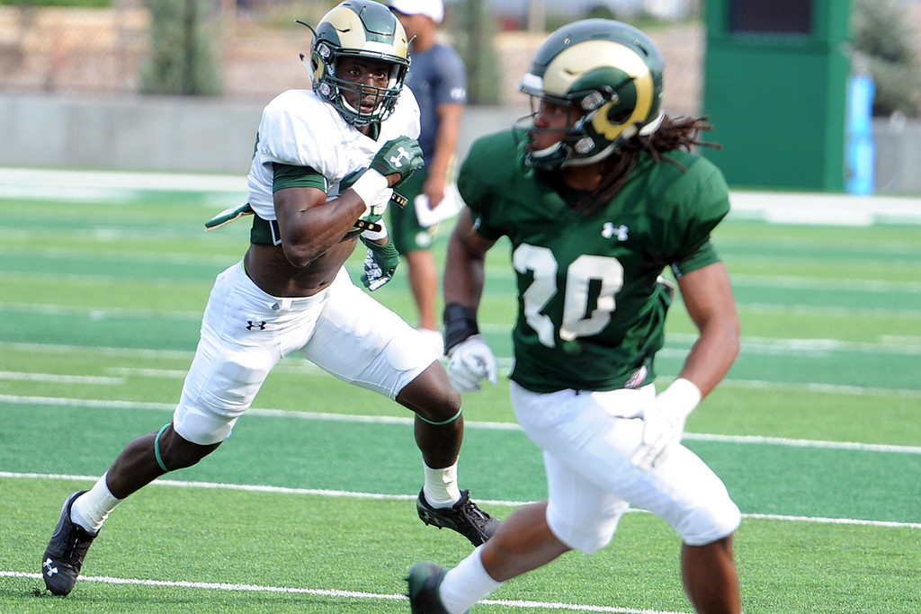 . Colorado State defensive back Logan Stewart pursues receiver A\'Jon Vivens during practice Thursday, August 2, 2018 in Fort Collins, Colorado. (Sean Star/Loveland Reporter-Herald)