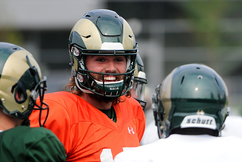 Colorado State quarterback Collin Hill talks with some teammates during practice Thursday, August 2, 2018 in Fort Collins, Colorado. (Sean Star/Loveland Reporter-Herald)