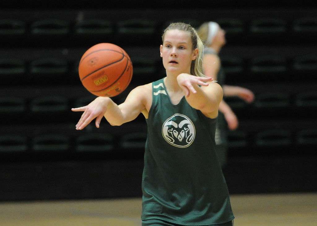 . Senior Stine Austgulen passes to a teammate during a recent practice at Moby Arena in Fort Collins.