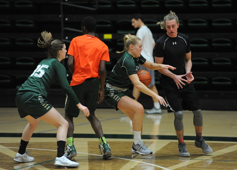 Junior Sofie Tryggedsson, middle right, and teammate Lore Devos (35) work on a defensive drill during a recent practice at Moby Arena in Fort Collins.