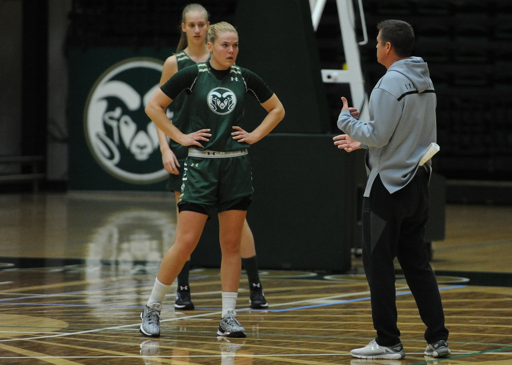 . Rams junior Sofie Tryggedsson listens to instruction from CSU women\'s basketball coach Ryun Williams at practice at Moby Arena in Fort Collins.