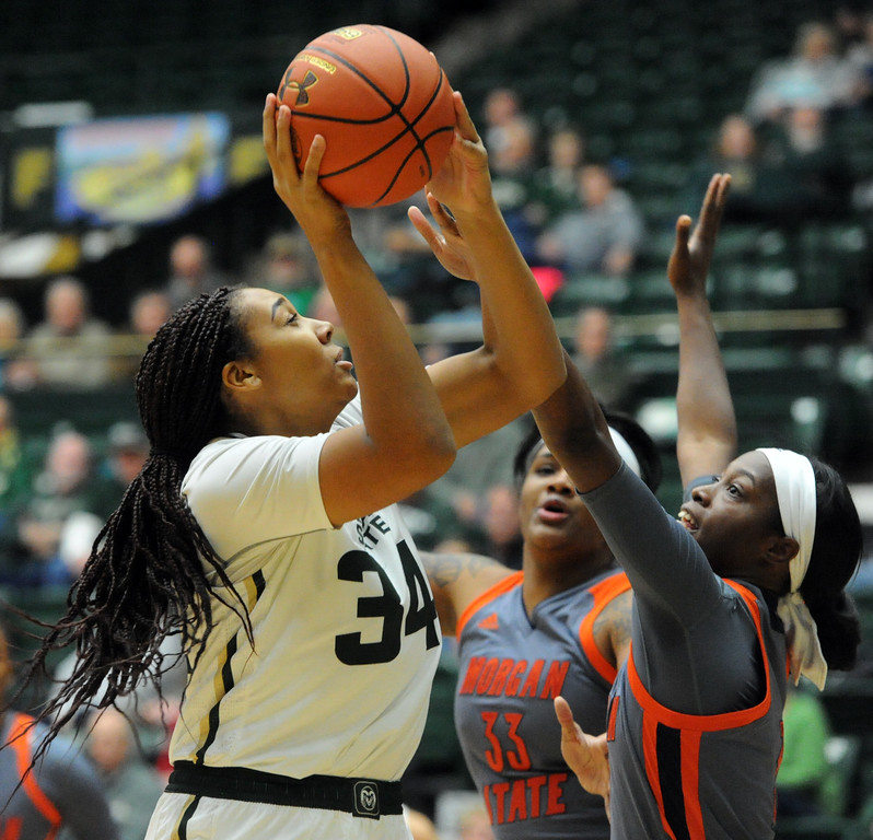 Colorado State's Liah Davis looks to shoot against a pair of Morgan State defenders on Thursday at Moby Arena. (Sean Star/Loveland Reporter-Herald)