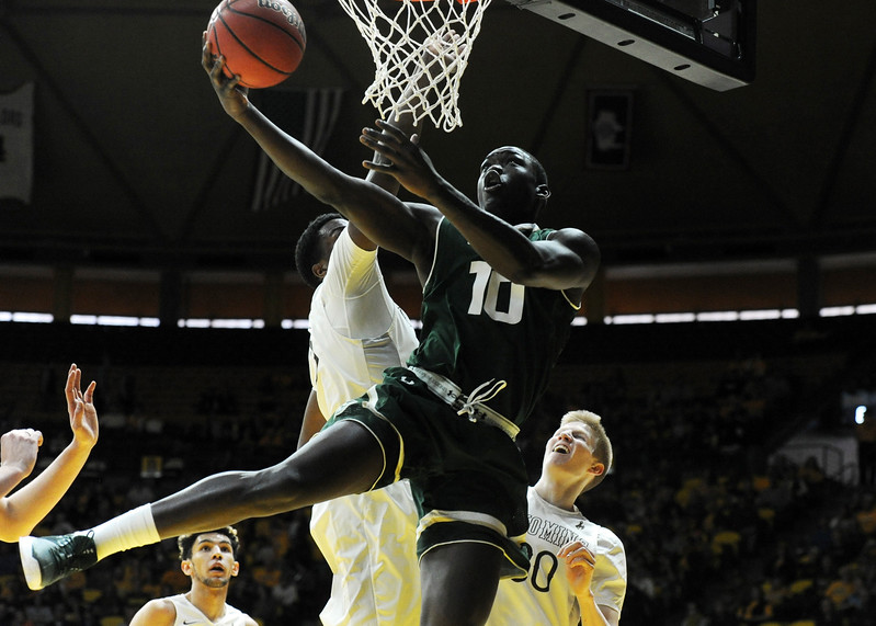 Colorado State's Che Bob goes up for a layup against the defense of Wyoming's Alan Herndon at the Arena-Auditorium in Laramie, Wyoming, on Saturday. (Sean Star / Loveland Reporter-Herald)