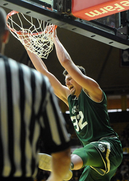 Colorado State's Nico Carvacho finishes a dunk against Wyoming at the Arena-Auditorium in Laramie, Wyoming, on Saturday. (Sean Star / Loveland Reporter-Herald)